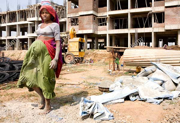 a-pregnant-women-worker-at-a-construction-site-with-her-hands